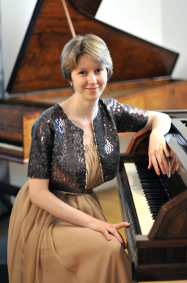 Dr Elena Vorotko sitting at the piano