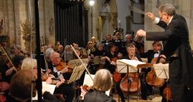 Martin Henderson conducting the DCO in Wimborne Minster